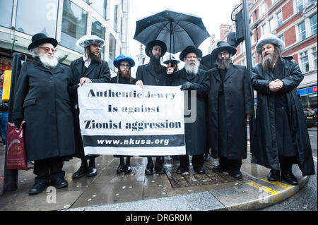 London, UK. 26th Jan, 2014. A group of Orthodox Jews from Neturei Karta hold a banner reading 'Authentic Jewry is - Stock Photo