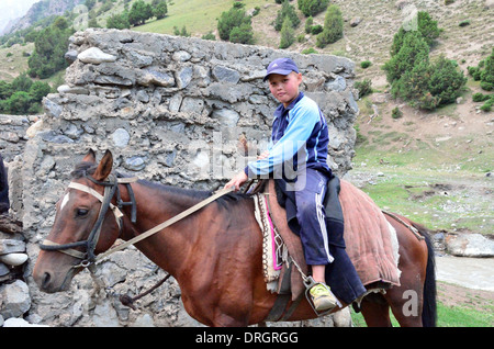 Kyrgyz horse rider in the mountains of southern Kyrgyztan - Stock Photo