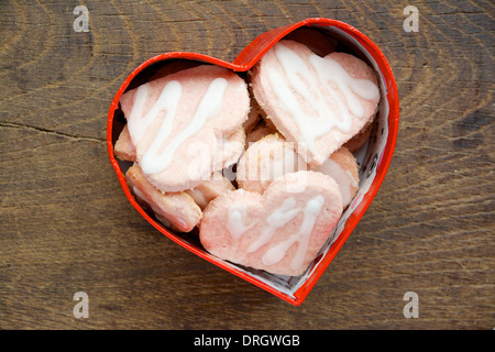 Heart shaped coconut cookies in a red heart shaped box. - Stock Photo