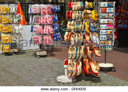 wooden dutch clogs on a stand for sale in a gift shop in valkenburg holland netherlands - Stock Photo