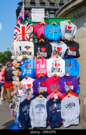 Assorted I Love London T shirts on souvenir stall set up around the base of the Boadicea Chariot sculpture at Westminster - Stock Photo
