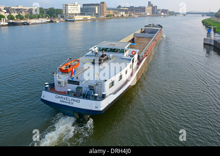 Early morning looking down from above at empty motor barge on the River Meuse at Maastricht Limburg, Netherlands - Stock Photo