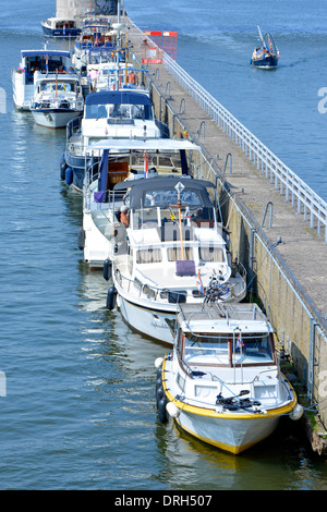 River Meuse (maas) & long quay wall divides m ain channel & providing moorings for visiting motorboats between bridges - Stock Photo