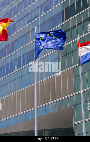 European flag with modern building on the background - Stock Photo