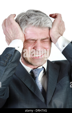 Businessman under pressure... having head ache... - Stock Photo