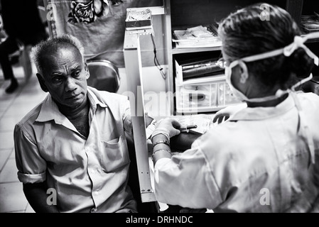 Indian man giving a blood sample in the labs at Sathya Sai Baba Super Speciality hospital. Puttaparthi, Andhra Pradesh, - Stock Photo