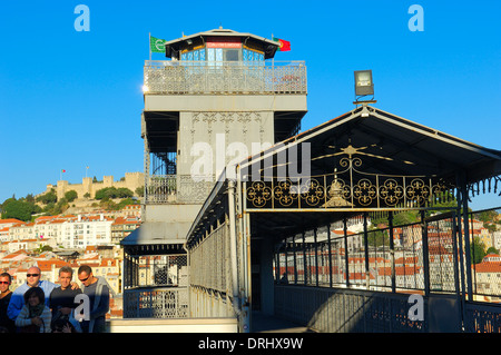 Lisbon, Tourist at Santa Justa elevator and St. George´s Castle at background, Elevador de Santa Justa, Castelo - Stock Photo