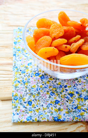 dried apricots in a bowl, food closeup - Stock Photo