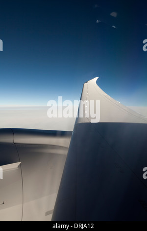 Dreamliner 787 general electric engine and wing viewed from passenger window - Stock Photo