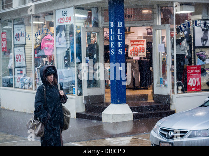 Passer-by in Chinatown in New York contend with even more snow - Stock Photo