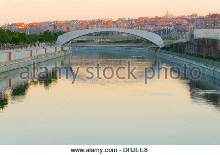 Modern bridge over rio manzanares in the morning - Stock Photo