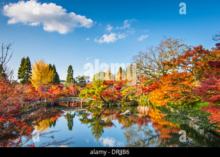 Kyoto, Japan at the pond and bridge of Eikando Temple in the Autumn. - Stock Photo
