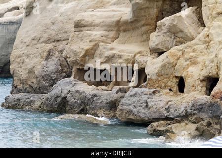 Matala caves on a Greek island of Crete - Stock Photo
