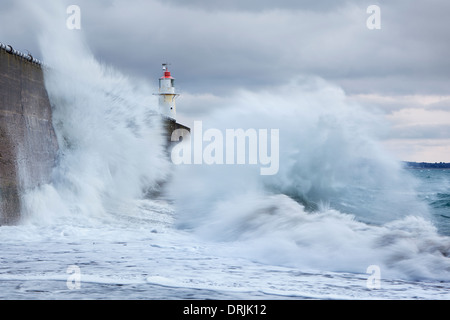 Large waves colliding into the sea wall at Newlyn - Stock Photo