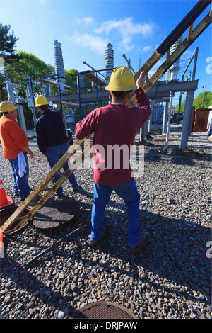 Power engineers working at high voltage power distribution station, Braintree, Massachusetts, USA - Stock Photo