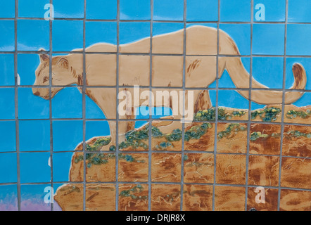A mountain lion is captured on this tile art outside the New Mexico Museum of Natural History in Albuquerque. - Stock Photo