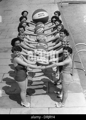 A group of women in swimsuits and beach balls, Butlins - Stock Photo
