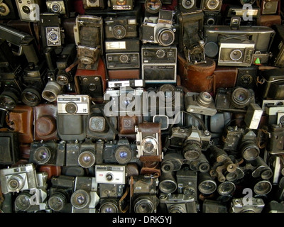 Vintage camera collection for sale on market stall in Morocco - Stock Photo