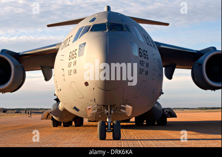 A US Air Force C-17 Globemaster III cargo aircraft is parked at Geronimo Landing Zone during a field training exercise - Stock Photo