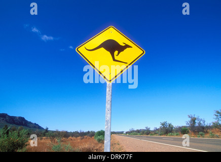 Kangaroo warning sign on an empty outback road in the Flinders range national park near Wilpena South Australia - Stock Photo