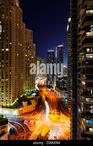Buildings and street in Dubai Marina at night. King Salman Bin Abdulaziz Al Saud st. - Stock Photo