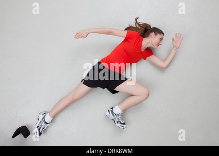 overhead view of fitness woman lying on mat using mobile