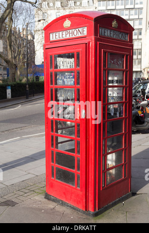 Old-fashioned red telephone box on Hanover Square, London. - Stock Photo