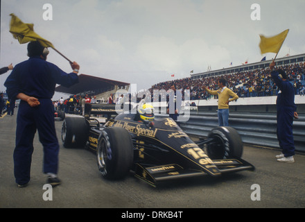 Ayrton Senna in his JPS Lotus-Renault GP car in the pit lane at Estoril race track Portuguese Grand Prix 1985 - Stock Photo