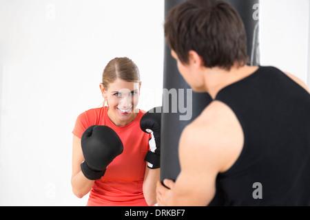 Austria, Klagenfurt, Couple in boxing training - Stock Photo