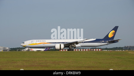 Jet Airways Boeing 777-300 slowing down after landing - Stock Photo