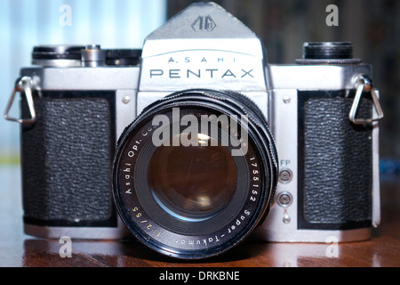 A Pentax S1a single lens reflex camera with an f2 ,55mm Takumar lens. - Stock Photo