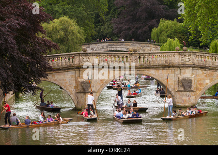 People punting on River Cam Clare Bridge background, Cambridge, England - Stock Photo
