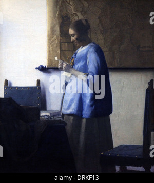 Woman Reading a Letter.Johannes Vermeer 1663 - Stock Photo