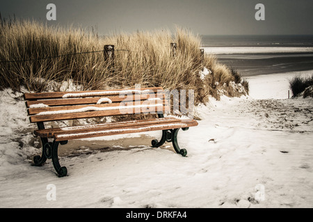 Germany, Lower Saxony, bench at the beach of Langeoog - Stock Photo