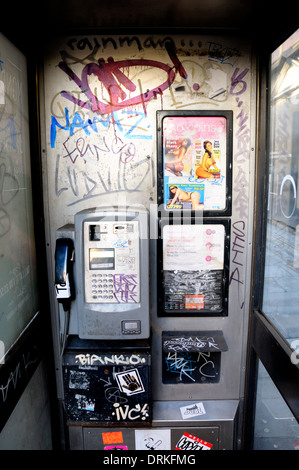London, England, UK. Vandalised telephone box with prostitute's adverts [phone numbers removed digitally] - Stock Photo