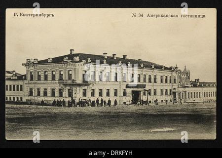 Amerikanskaya Hotel (American Hotel) in Yekaterinburg, Russian Empire. Old postcard. - Stock Photo