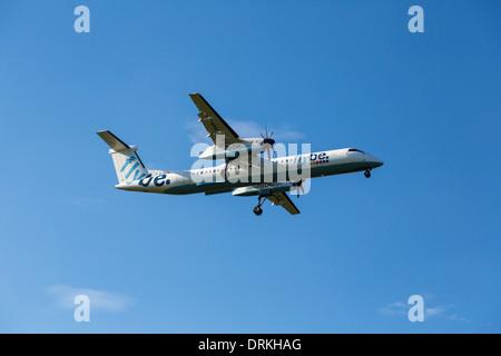 Flybe De Havilland dash 8 to land - Stock Photo