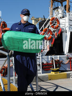 US Coast Guard Chief Petty Officer Raymond Kneen offloads 2,500 pounds of cocaine worth an estimated $37 million wholesale value January 28, 2014 in Miami Beach, FL. The contraband was seized in a multi-national counter-drug operation south of the Dominican Republic.