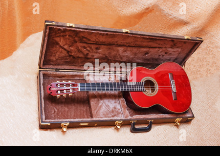 Acoustic guitar and its case. Stock Photo