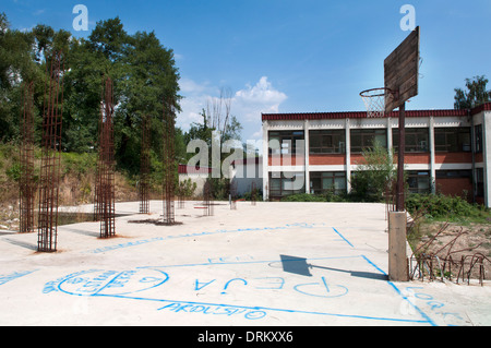 A basketball court among rebars, Peć, Kosovo - Stock Photo
