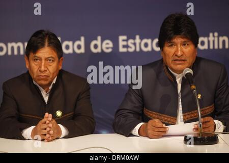 Havana, Cuba. 28th Jan, 2014. Bolivian President, Evo Morales (R), speaks at a press conference where he confirmed - Stock Photo