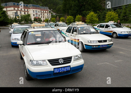 Chinese taxi drivers waiting for passengers / taxis driver / in their cars at a large and very neat and organised - Stock Photo