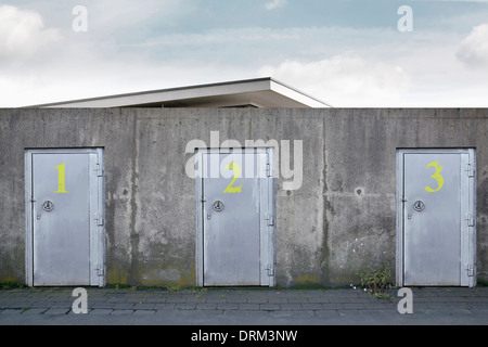 Building behind a wall with three safety doors, composing - Stock Photo