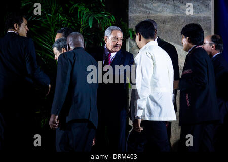 Havana, Cuba. 28th Jan, 2014. Cuban President Raul Castro (C) greets other dignitaries before the family photo shotting - Stock Photo