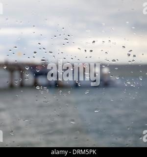 Germany,  Schleswig-Holstein, Heiligenhafen, raindrops on window. pier - Stock Photo