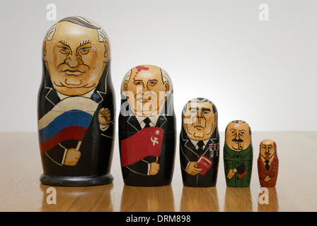 Russian Matryoshka dolls painted as Russian leaders. L- R; Yeltsin, Gorbachev, Brezhnev, Stalin, Lenin. - Stock Photo