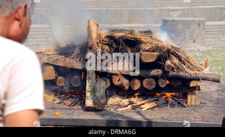 death corpse burning cremation fire, pashupatinath temple, kathmandu, nepal - Stock Photo