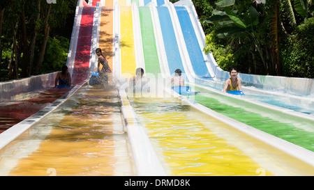 Children on water slide fun Nha Trang Vietnam South East Asia - Stock Photo