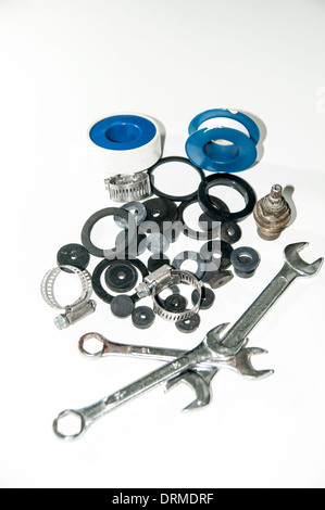 washers and plumbing tools On white Background - Stock Photo