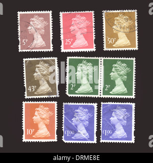 Britain UK Selection of various used British Royal Mail postage stamps close-up - Stock Photo